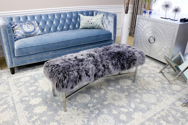 Living room with velvet sofa and furry ottoman