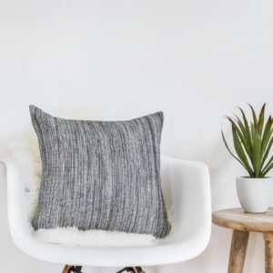 White chair with Black and White Story Throw Pillow
