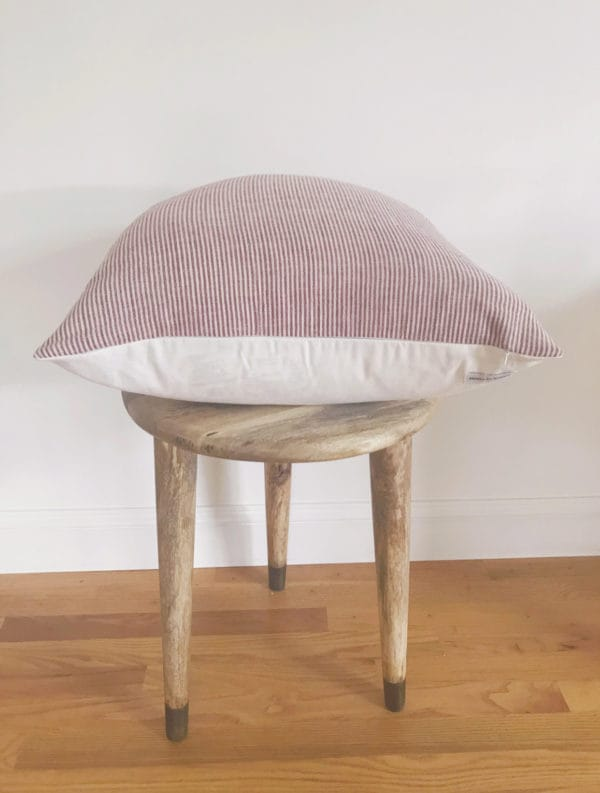 Red and white striped pillow cushion