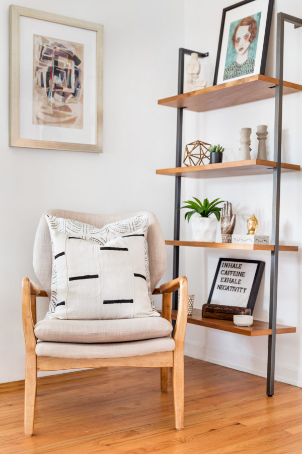 Wooden Chair with Patterned Throw Pillow