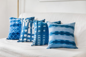 Blue Throw Pillows on White Sofa