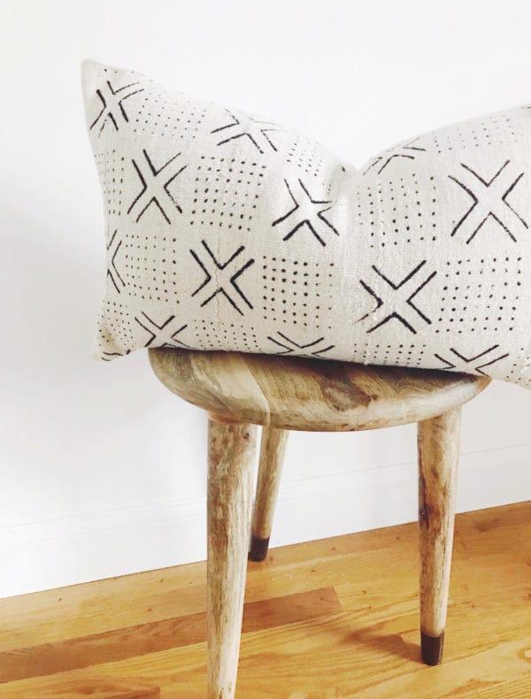 Rectangular white and black throw pillow and stool
