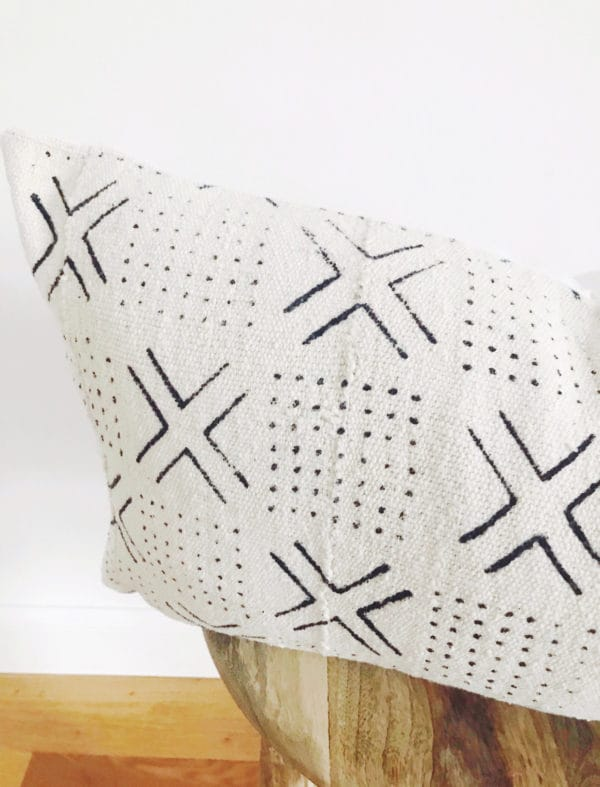 White and black patterned mud cloth pillow