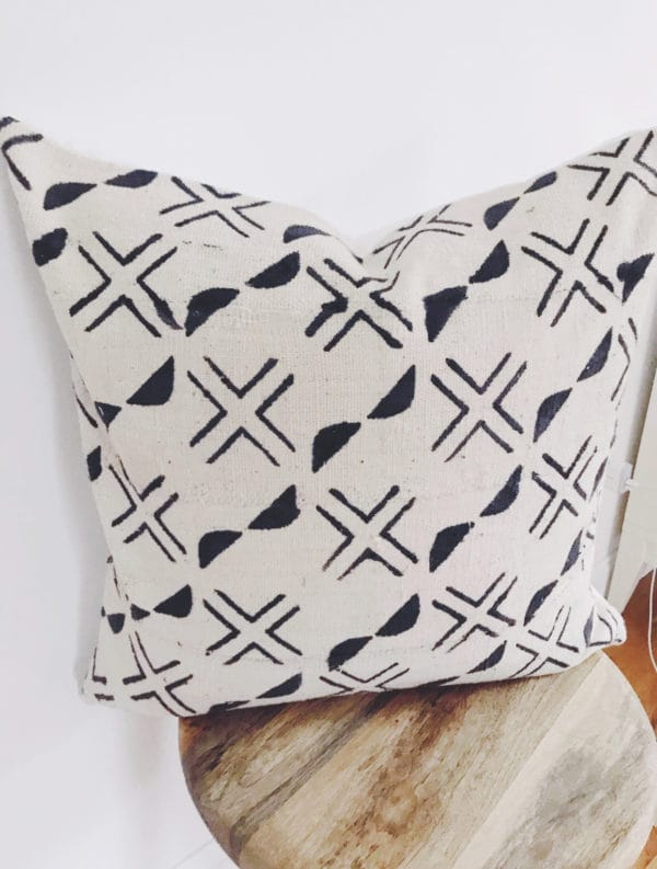 Square throw pillow with white and black pattern design