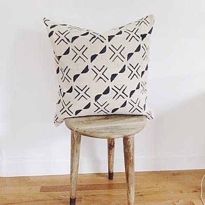 Mud cloth throw pillow with white and black pattern
