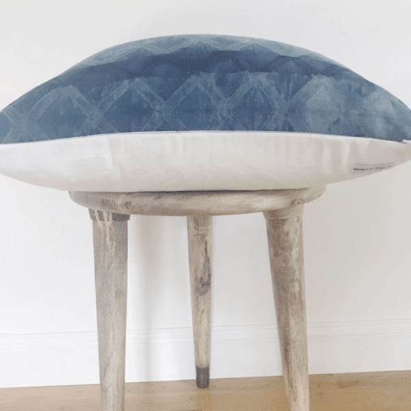 Close up of wooden stool and blue pillow