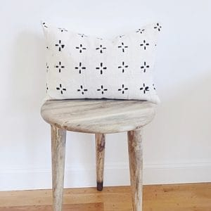 White throw pillow with black pattern