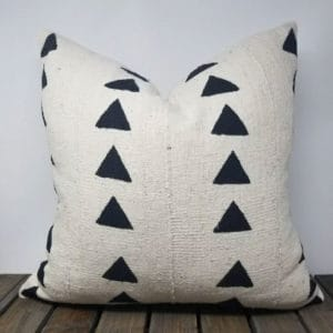 White throw pillow with black diamond design