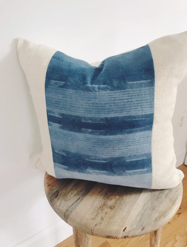 Throw pillow with blue pattern