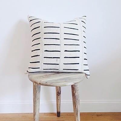 White throw pillow with black stripe design