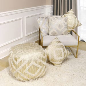 Metallic throw pillows and pouf ottoman