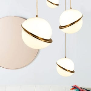 Pendant lighting over white couch