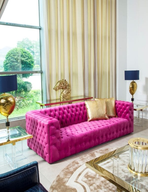 Living room with bright pink sofa