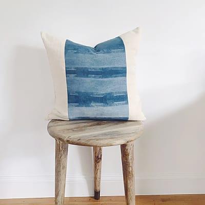Detail shot of blue pattern on throw pillow