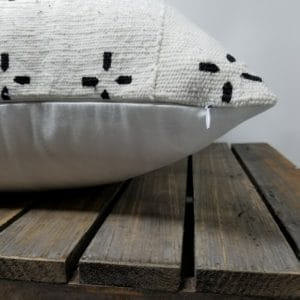 White pillow with white zipper